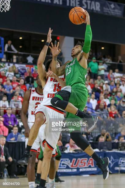 Marshall Thundering Herd guard Rondale Watson drives to the rim with Western Kentucky Hilltoppers guard Darius Thompson defending during the...