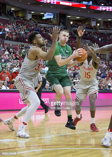 Marshall Thundering Herd guard Stevie Browning dribbles the ball between Ohio State Buckeyes center Trevor Thompson and Ohio State Buckeyes guard Kam...