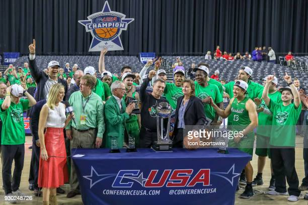 Marshall Thundering Herd head coach Dan D'Antoni celebrate with his players after winning the Conference USA Basketball Championship game between the...