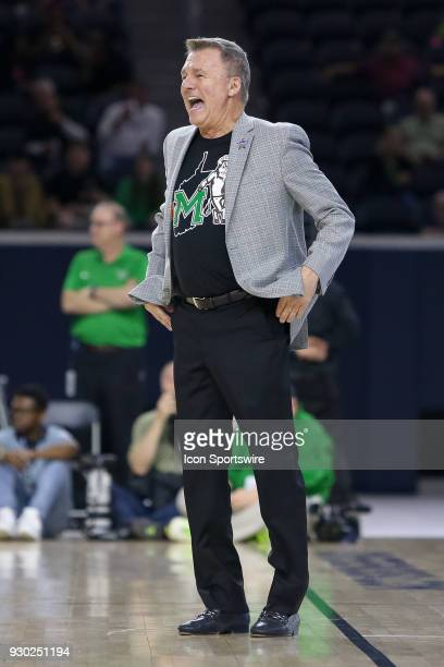 Marshall Thundering Herd head coach Dan D'Antoni laughs during the Conference USA Basketball Championship game between the Western Kentucky...
