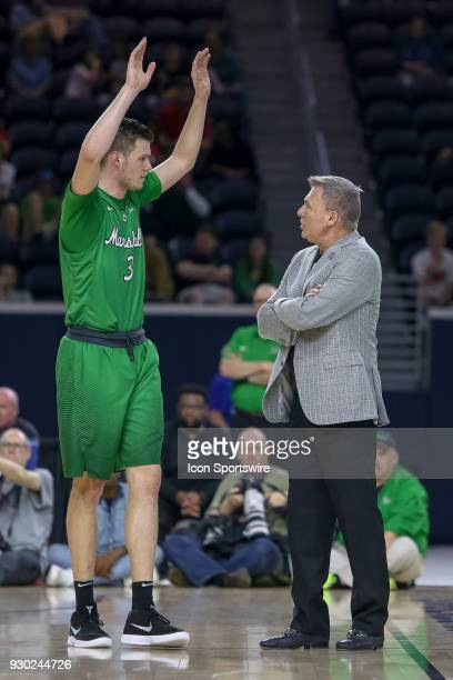 Marshall Thundering Herd head coach Dan D'Antoni talks with Marshall Thundering Herd forward Jannson Williams during the Conference USA Basketball...