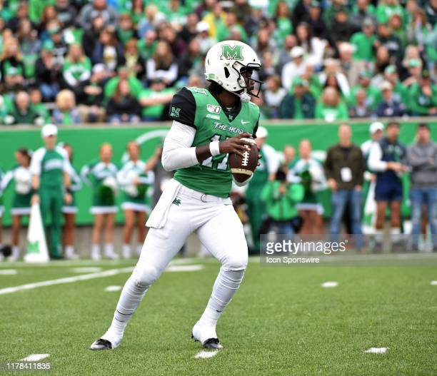 Marshall Thundering Herd quarterback Isaiah Green stands in the pocket during a college football game between the Western Kentucky Hilltoppers and...
