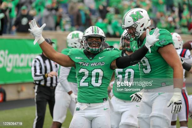 Marshall Thundering Herd running back Brenden Knox celebrates after scoring on a 58yard pass reception during the first quarter of the college...