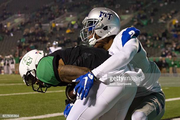 Marshall Thundering Herd WR Justin Hunt makes a 28yard touchdown catch as Middle Tennessee Blue Raiders CB Charvarius Ward defends during the third...