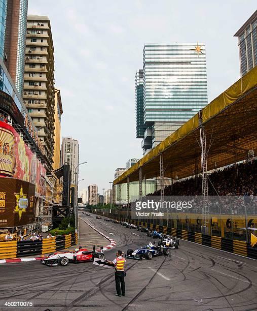 Marshalls alert cars of a crash at the Lisboa Curve during the Formula 3 event as part of the 60th Macau Grand Prix on November 17 2013 in Macau Macau