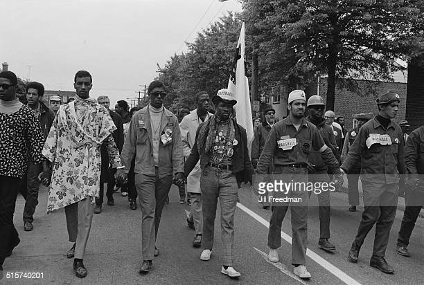 Marshalls march through a US town on their way to Washington DC during the Poor People's Campaign 1968