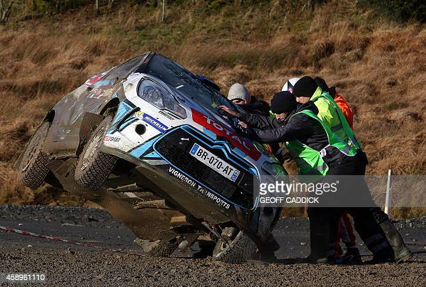 Marshalls put right the Citroen DS3 R3T of French rally driver Quentin Giordano and his French codriver Valentin Sarreaud after they rolled while...