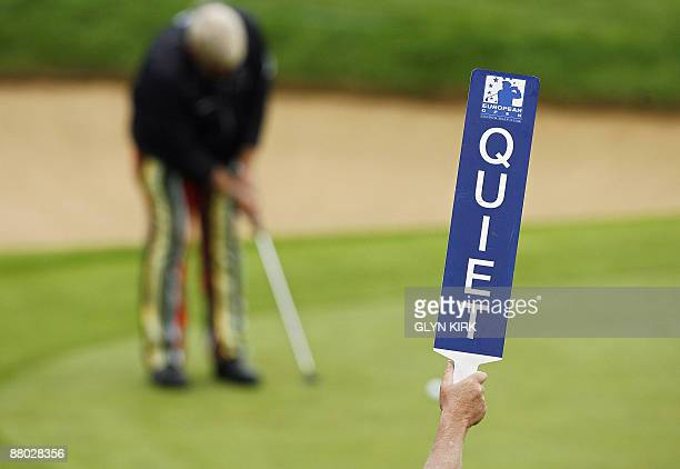 A marshall's sign is pictured as US golfer John Daly putts during the first day of the European Open at the London Club in Ash in Kent southeast...