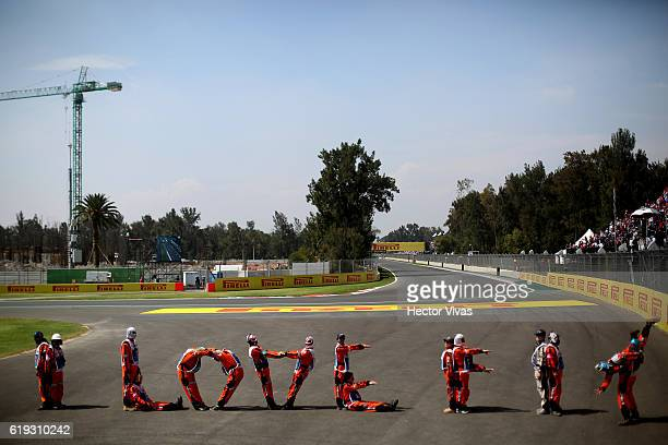 Marshalls wearing wrestling masks perform a human form with the phrase I love F 1 before the Formula 1 Grand Prix of Mexico at Autodromo Hermanos...