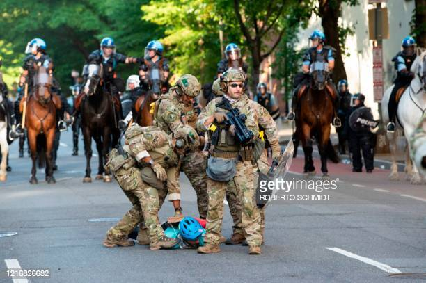 US Marshals are restraining a protestor near the White House on June 1 2020 as demonstrations against George Floyd's death continue Police fired tear...