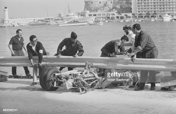 Marshal's clearing the smashed car of driver Clay Regazzoni following his crash at the Monte Carlo Grand Prix Monaco 24th May 1968