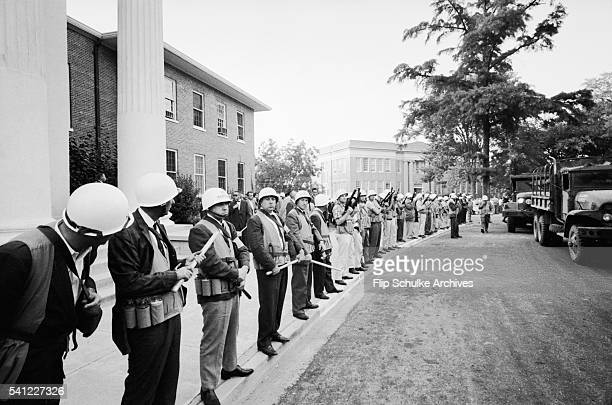 Marshals line up in front of the Lyceum on the University of Mississippi campus during riots over desegregation of the school.