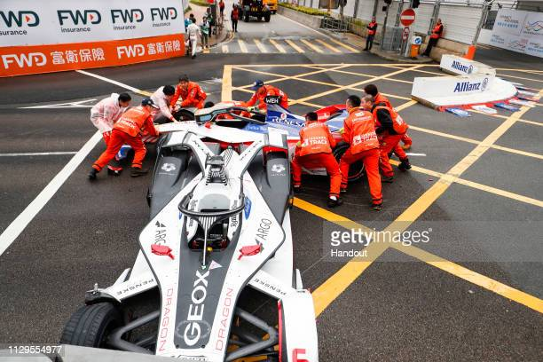 Marshals work to remove the cars of Felipe Nasr GEOX Dragon Racing Penske EV3 and Pascal Wehrlein Mahindra Racing M5 Electro after colliding on March...