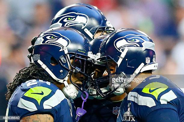 Marshawn Lynch and Russell Wilson of the Seattle Seahawks celebrate after a three yard touchdown by Lynch in the second quarter against the New...