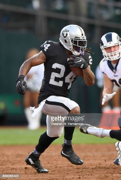 Marshawn Lynch of the Oakland Raiders carries the ball against the Los Angeles Rams during the first quarter of their preseason NFL football game at...