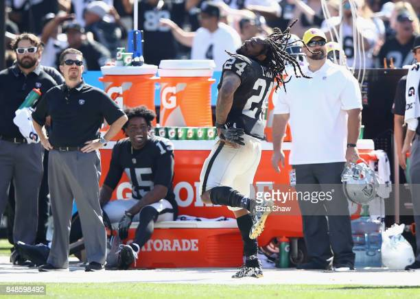 Marshawn Lynch of the Oakland Raiders dances on the sideline during their win over the New York Jets at OaklandAlameda County Coliseum on September...