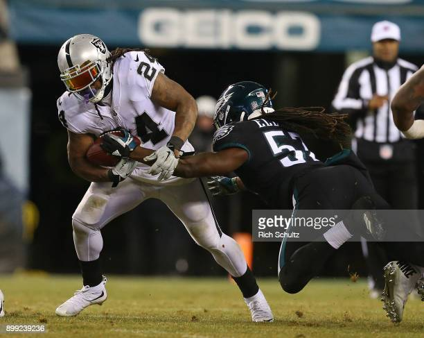 Marshawn Lynch of the Oakland Raiders fights off Dannell Ellerbe of the Philadelphia Eagles during a game at Lincoln Financial Field on December 25...