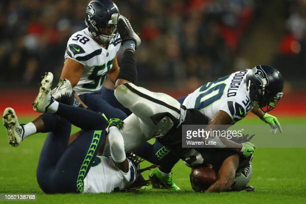 Marshawn Lynch of the Oakland Raiders is tackled by Bradley McDougald of the Seattle Seahwks during the NFL International Series game between Seattle...