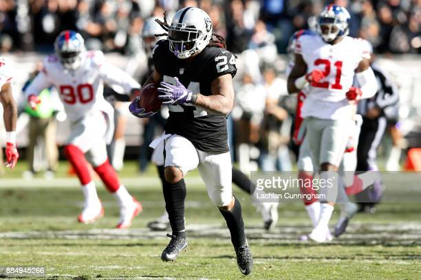 Marshawn Lynch of the Oakland Raiders runs for a 51yard touchdown against the New York Giants during their NFL game at OaklandAlameda County Coliseum...