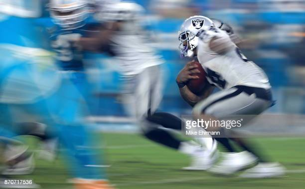 Marshawn Lynch of the Oakland Raiders rushes during a game against the Miami Dolphins at Hard Rock Stadium on November 5 2017 in Miami Gardens Florida