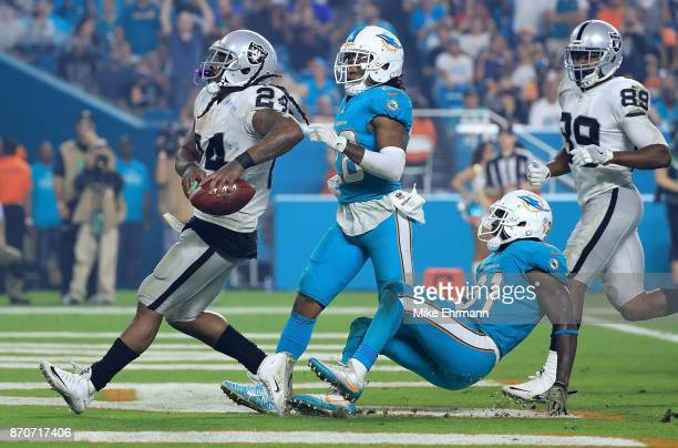 Marshawn Lynch of the Oakland Raiders scores a touchdown during a game against the Miami Dolphins at Hard Rock Stadium on November 5 2017 in Miami...