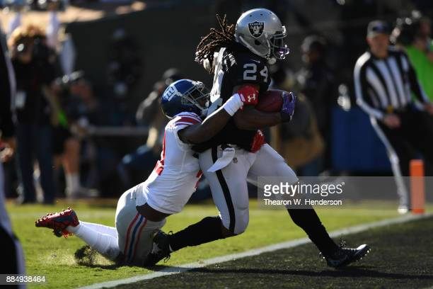 Marshawn Lynch of the Oakland Raiders scores on a 51yard run against the New York Giants during their NFL game at OaklandAlameda County Coliseum on...
