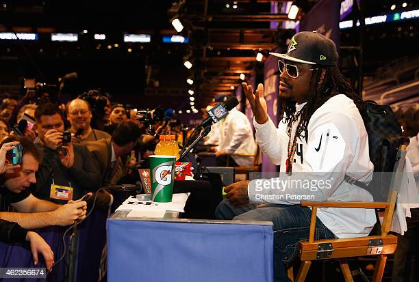 Marshawn Lynch of the Seattle Seahawks addresses the media at Super Bowl XLIX Media Day Fueled by Gatorade inside US Airways Center on January 27...