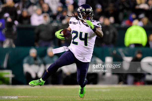 Marshawn Lynch of the Seattle Seahawks carries the ball for a first down in the third quarter of the NFC Wild Card Playoff game against the...