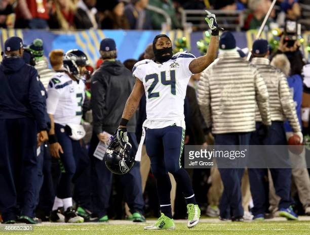 Marshawn Lynch of the Seattle Seahawks celebrates on the sidelines during the third quarter against the Denver Broncos during Super Bowl XLVIII at...
