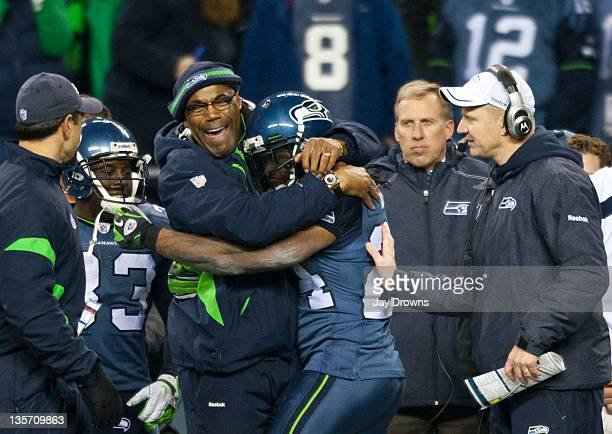 Marshawn Lynch of the Seattle Seahawks celebrates with Sherman Smith running back coach after a touch down against the St Louis Rams at CenturyLink...