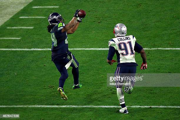 Marshawn Lynch of the Seattle Seahawks completes a catch against Tyler Gaffney of the New England Patriots in the fourth quarter during Super Bowl...