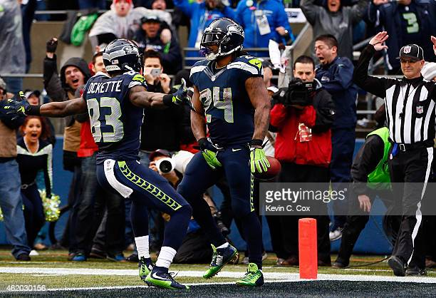 Marshawn Lynch of the Seattle Seahawks gestures after scoring a touchdown against the Green Bay Packers during the 2015 NFC Championship game at...