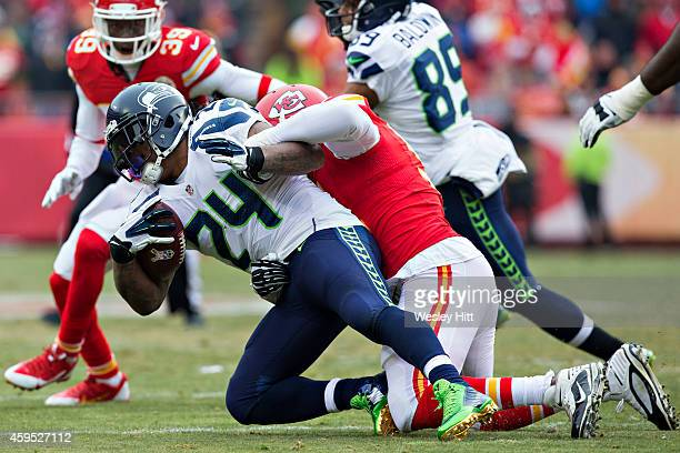 Marshawn Lynch of the Seattle Seahawks is tackled in the second quarter by Tamba Hali of the Kansas City Chiefs at Arrowhead Stadium on November 16...