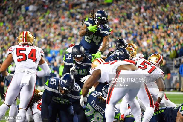 Marshawn Lynch of the Seattle Seahawks leaps and scores during the during the fourth quarter of the game against the San Francisco 49ers at...