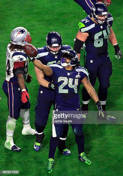 Marshawn Lynch of the Seattle Seahawks reacts after a play in the third quarter against the New England Patriots during Super Bowl XLIX at University...