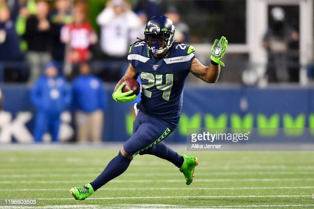 Marshawn Lynch of the Seattle Seahawks runs the ball during the third quarter of the game against the San Francisco 49ers at CenturyLink Field on...