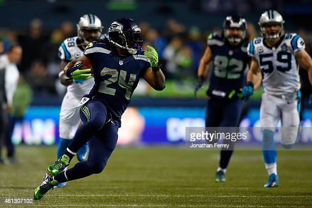Marshawn Lynch of the Seattle Seahawks runs the ball in the third quarter against the Carolina Panthers during the 2015 NFC Divisional Playoff game...