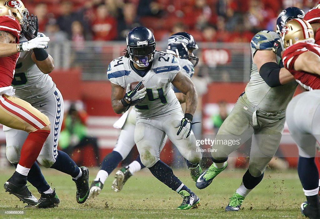 Marshawn Lynch #24 of the Seattle Seahawks runs up the middle against the San Francisco 49ers in the fourth quarter at Levi's Stadium on November 27, 2014 in Santa Clara, California.