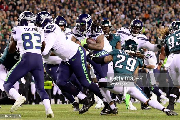 Marshawn Lynch of the Seattle Seahawks rushes for a touchdown over the defense of the Philadelphia Eagles in the second quarter of the NFC Wild Card...