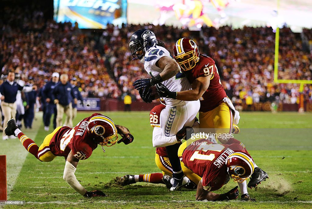 Marshawn Lynch #24 of the Seattle Seahawks scores a fourth quarter touchdown against the defense of Lorenzo Alexander #97 of the Washington Redskins during the NFC Wild Card Playoff Game at FedExField on January 6, 2013 in Landover, Maryland.