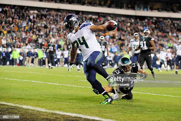 Marshawn Lynch of the Seattle Seahawks scores a touchdown against Nate Allen of the Philadelphia Eagles during the third quarter of the game at...
