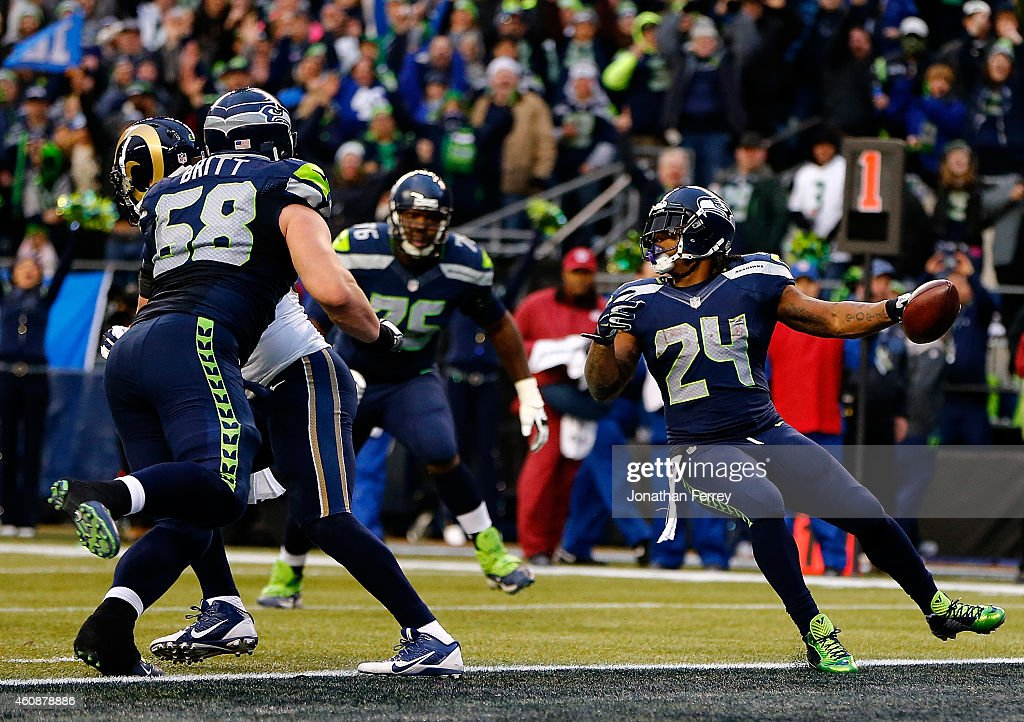 Marshawn Lynch #24 of the Seattle Seahawks scores a touchdown against the St. Louis Rams at CenturyLink Field on December 28, 2014 in Seattle, Washington.