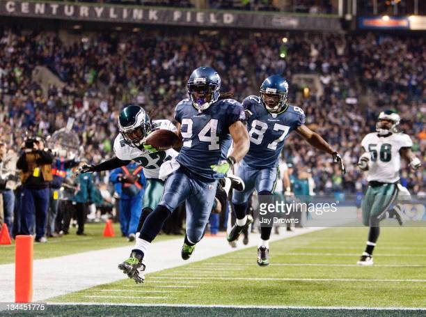 Marshawn Lynch of the Seattle Seahawks scores as he out runs Asante Samuel of the Philadelphia Eagles at CenturyLink Field December 1 2011 in Seattle...