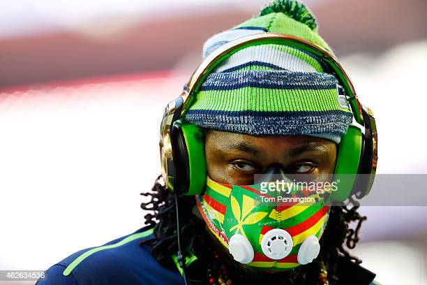 Marshawn Lynch of the Seattle Seahawks stands on the field prior to Super Bowl XLIX at University of Phoenix Stadium on February 1 2015 in Glendale...