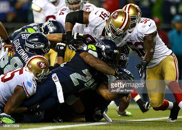 Marshawn Lynch of the Seattle Seahawks stretches the ball across the goal line for a touchdown against the San Francisco 49ers on September 15 2013...