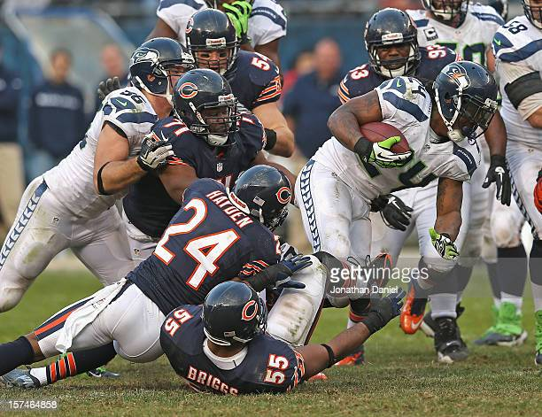 Marshawn Lynch of the Seattle Seahawks tries to break away from Lance Briggs Kelvin Hayden and Israel Idonije of the Chicago Bears at Soldier Field...