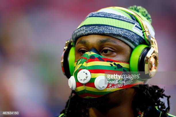 Marshawn Lynch of the Seattle Seahawks warms up prior to Super Bowl XLIX against the New England Patriots at University of Phoenix Stadium on...