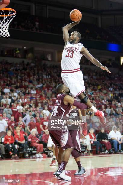 Marshawn Powell of the Arkansas Razorbacks goes up for a dunk over Trivante Bloodman of the Mississippi State Bulldogs but is called for a charge at...