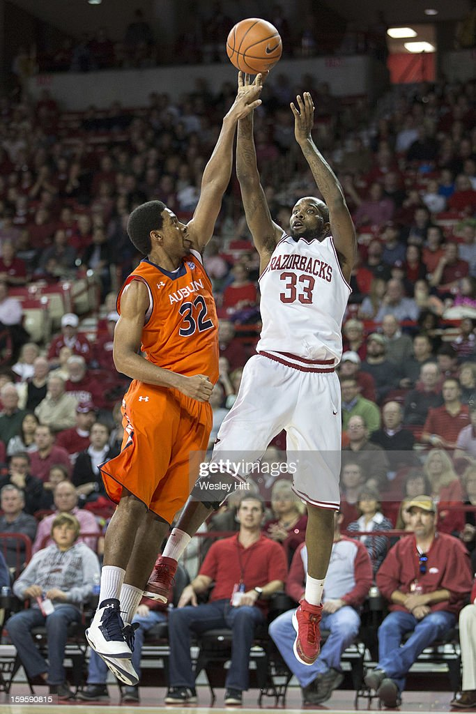 Marshawn Powell #33 of the Arkansas Razorbacks shoots a jump shot over Noel Johnson #32 of the Auburn Tigers at Bud Walton Arena on January 16, 2013 in Fayetteville, Arkansas. The Razorbacks defeated the Tigers 88-80.