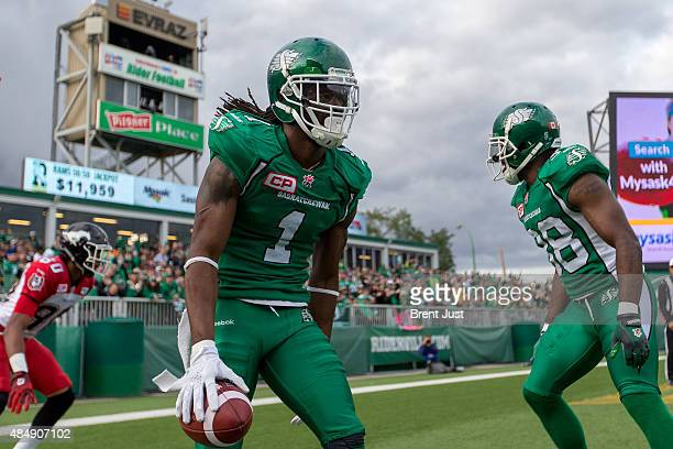 Marshay Green of the Saskatchewan Roughriders celebrates an interception on a two point conversion attempt in first half action in a game between the...